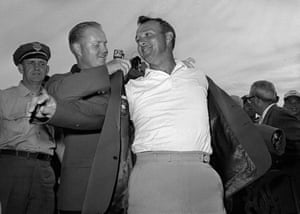 April 12 1964-Arnold Palmer, right, slips into his green jacket with help from Jack Nicklaus after winning the Masters golf championship, in Augusta, Georgia.