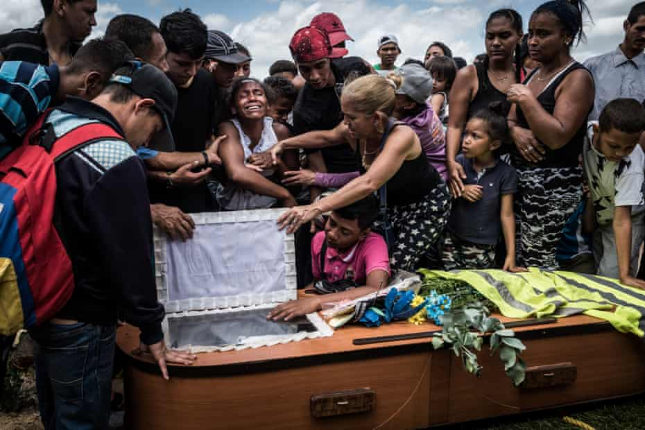 A woman cries during the funeral of her husband, Keiber Cubero, 25. Father to a little girl and struggling to find food, Keiber went to rob a restaurant with two friends during the night. They were caught and killed by police officers while fleeing the scene