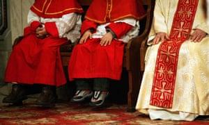 Choir boys next to a Roman Catholic priest during Christmas eve mass.