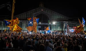 Catalan pro-independence supporters celebrate in Barcelona after Junts pel Sí won Sunday's regional elections.