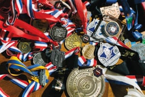 A collection of Elizabeth Swaney's medals, trophies and accolades from various sports and competitions at her home in Oakland, California.