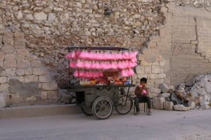 A child sells candy floss on a street cart in the al-Bab city, in the north of Aleppo province