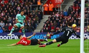 Pierre-Emerick Aubameyang of Arsenal has a shot saved by Alex McCarthy