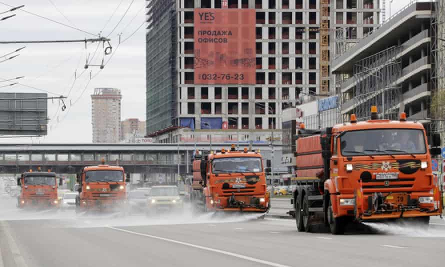 Vehicles wash the streets in Moscow
