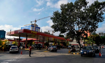Drivers queue to pump fuel at a gas station of Venezuelan state-owned oil company PDVSA in Caracas on Wednesday.