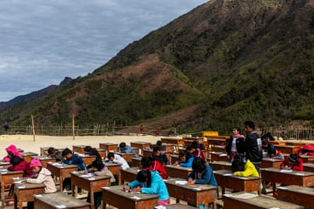 Students at a camp for displaced people take an exam in Hpare, in Myanmar's Kachon state