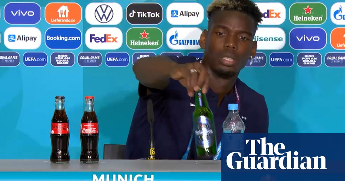 Paul Pogba moves sponsor's beer from view at Euro 2020 news conference