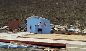 People work surrounded by debris in the aftermath of Hurricane Irma in Tortola.
