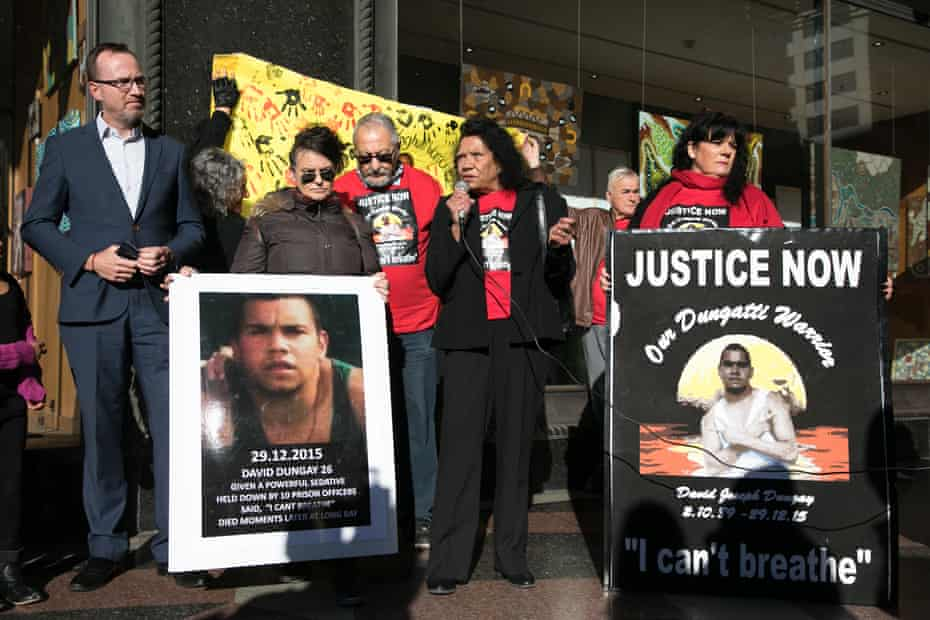 Leetona Dungay, the mother of David Dungay Jr, with family and supporters, outside the inquest into her son's death.