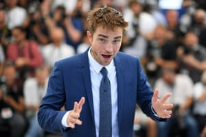 Robert Pattinson poses during a photocall for the film Good Time
