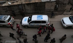 UN vehicles escorting a Red Crescent convoy carrying humanitarian aid for Syrian civilians arrive in a rebel-held area on the outskirts of Damascus in early 2016