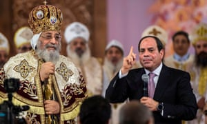 Egypt's president, Abdel Fatah al-Sisi, at a Christmas Eve mass with the Coptic pope, Tawadros II.