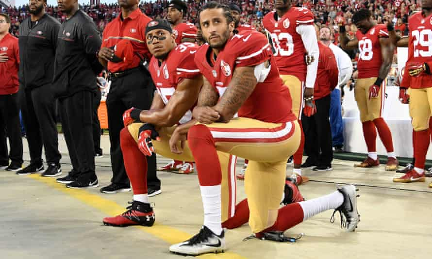Colin Kaepernick and Eric Reid kneel during the national anthem. September 2016.