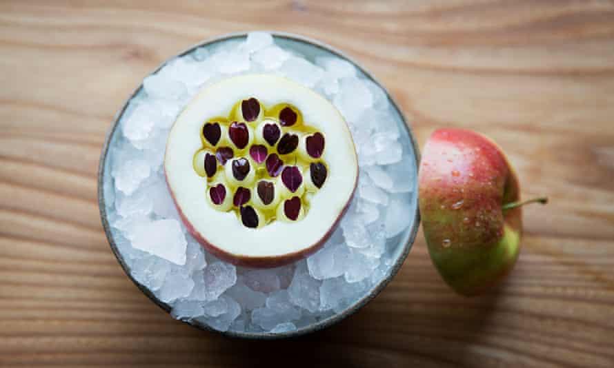 Apple of the season with oxalis, paste of fermented black apple and elderflower oil.
