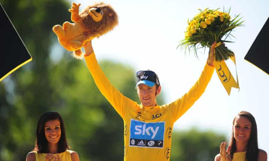 Bradley Wiggins celebrates winning the Tour de France with Team Sky in 2012.