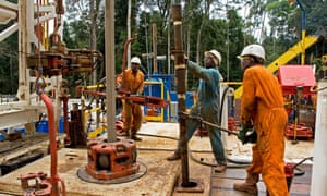 Workers in a remote rainforest in Gabon perform their duties on an onshore oil and gas rig site. Legislation targeting corruption in the global extractive industries is making slow progress.