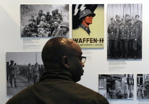 the farm belt fhrer the making of a neo nazi  world news  the  a visitor looks at photographs of ss troops and nazi propaganda at the  topography of terror