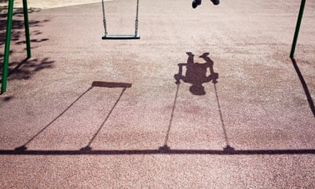 Shadow of child on a swing