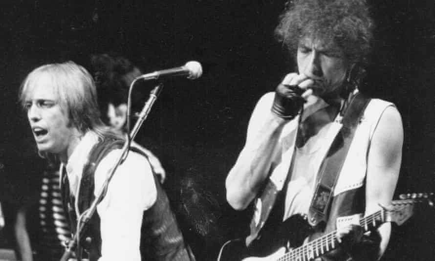 Tom Petty and Bob Dylan playing at Madison Square Garden, New York, in the 1980s.
