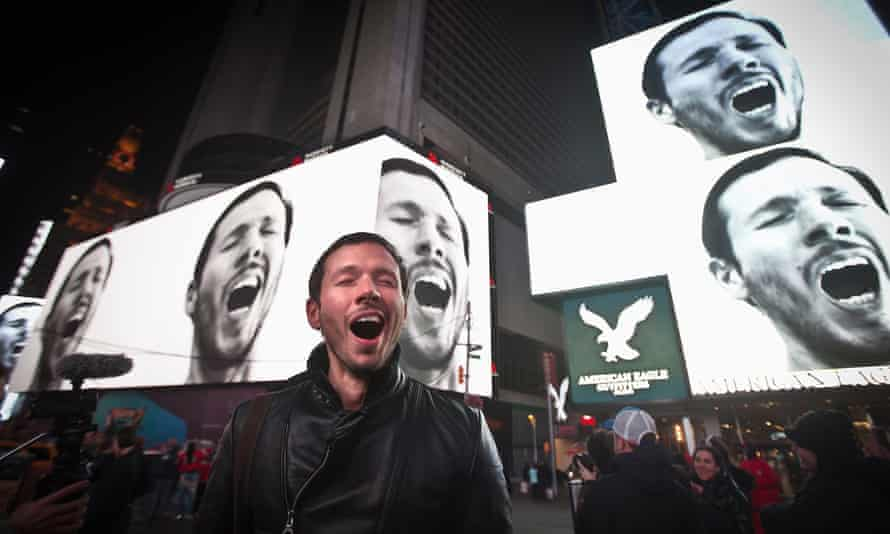 Sebastian Errazuriz in front of his video art installation A Pause in the City That Never Sleeps, which was projected on screens in Times Square in 2015.