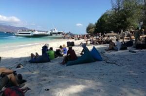 People wait on the beach at Gili Trawangan near Lombok Island.