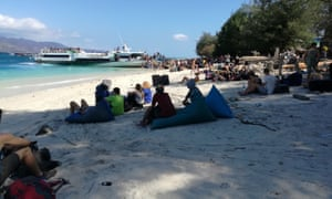 Tourists wait to be evacuated from Gili Trawangan off the coast of Lombok.