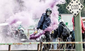 Protesters clash with riot police during a rally against the Austrian government's planned re-introduction of border controls at the Brenner pass.