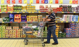A pensioner shops in an Aldi grocery store