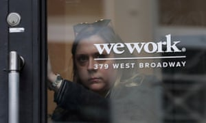 A woman exits a WeWork co-working space in New York City