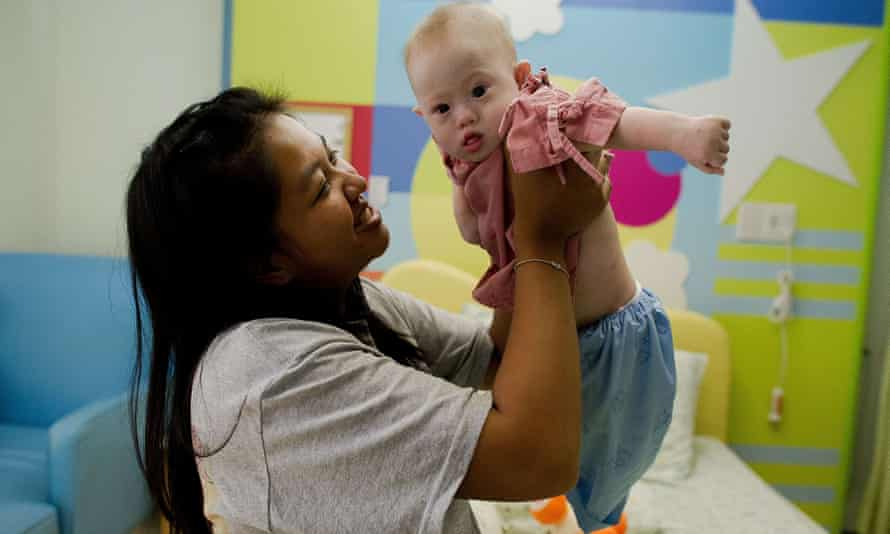 Baby Gammy with his surrogate mother, Pattaramon Chanbua, in Thailand last August. His twin sister, Pipah, will stay with West Australian couple Wendy Li and David Farnell.