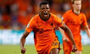Denzel Dumfries of Netherlands celebrates after scoring their third goal.