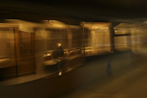 A man travels on a virtually empty metro train in Brussels, Belgium