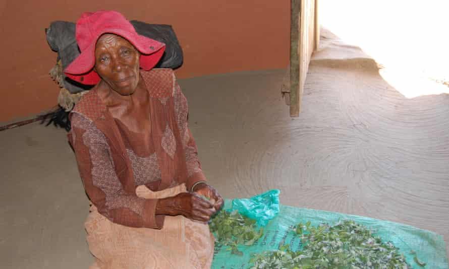 Marentseng Tjamela prepares a meal of vegetables and pap for her orphan grandchildren in Mafeteng