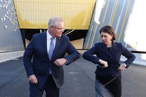 Prime minister Scott Morrison and NSW premier Gladys Berejiklian bump elbows in June.