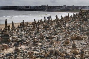 Whitley Bay, England. Pebble sculptures on the beach