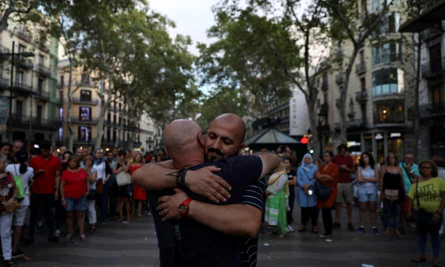 A Muslim man hugs passers-by at the site of the terrorist incident on the Ramblas in Barcelona