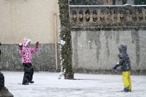 Two children play in the snow in Bunyola