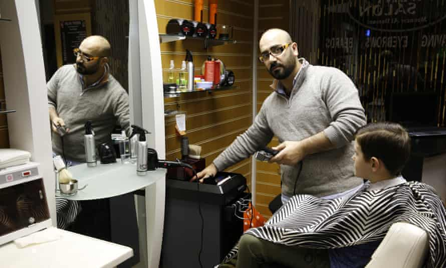 Mounzer al-Darsani, a barber from Damascus, runs a thriving business on the island.