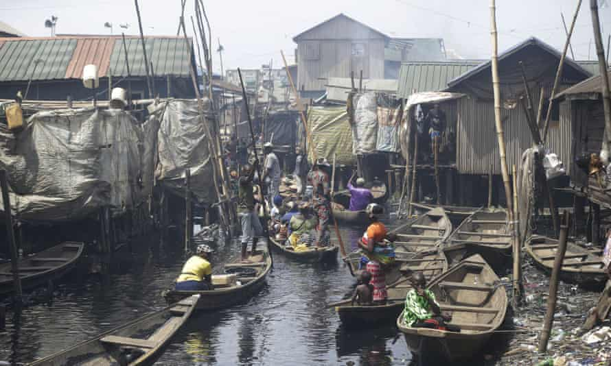 People crowded together in boats in  the floating slum of Makoko, in Lagos, Nigeria