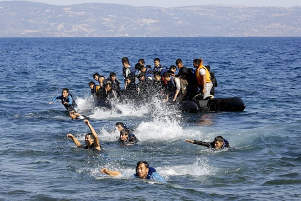 Afghan refugees swim ashore as their dinghy with a broken engine drifts off the Greek island of Lesbos during a crossing of the Aegean Sea from Turkey.