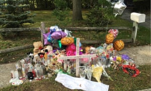 A memorial to best friends Nisa Mickens and Kayla Cuevas, both students at Brentwood High School, who were beaten and hacked to death by a carload of gang members. Donald Trump is scheduled travel to New York on Friday, July 28, to discuss the MS-13 gang.