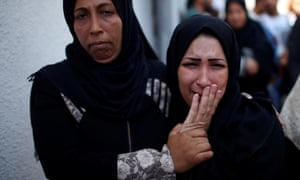 Mother of 8-month-old Palestinian infant Laila al-Ghandour, who died after inhaling tear gas during a protest against US embassy move to Jerusalem at the Israel-Gaza border, mourns during her funeral in Gaza City