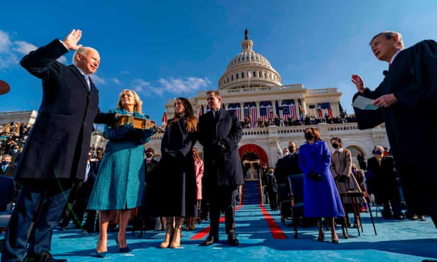 Joe Biden is sworn in as the 46th president of the US by the chief justice, John Roberts, as his wife Dr Jill Biden holds the Bible, alongside son Hunter and daughter of Joe and Jill Biden, Ashley, during the 59th presidential inauguration at the US Capitol in Washington DC