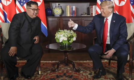 Donald Trump gives Kim Jong-un a thumbs-up at their meeting on Sentosa island in Singapore.