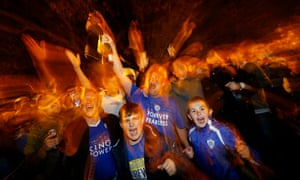 Leicester City fans celebrate in the street