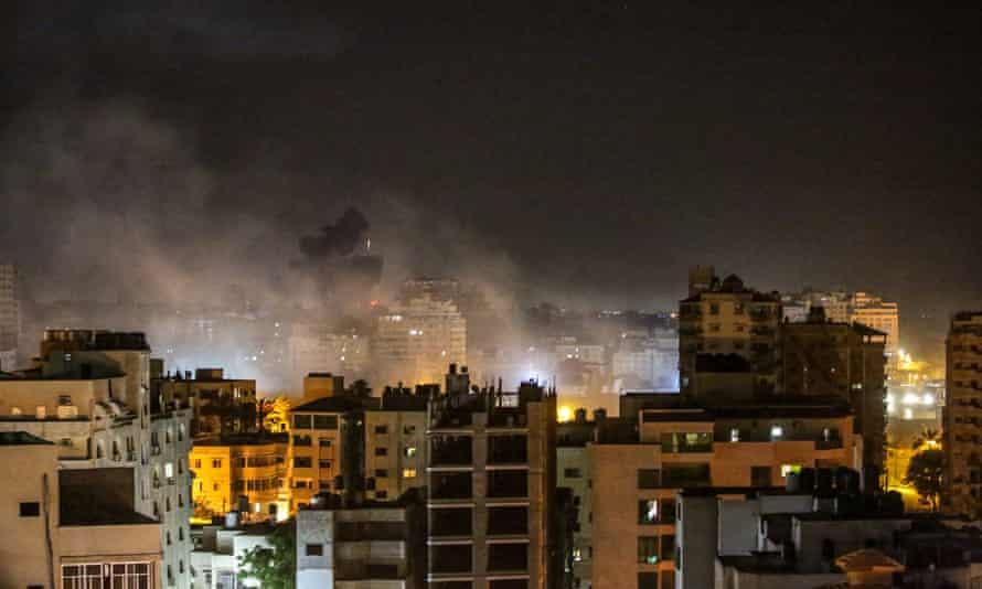 Smoke rises after Israeli airstrikes hit Gaza City on Monday.