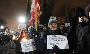 People protest in Warsaw against the ruling Law and Justice party after it intervened to appoint five judges of its choosing to the Constitutional Tribunal.
