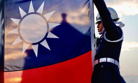 Guards raise Taiwan's national flag in Taipei. The US and Taiwan have agreed to a five-year deal pledging cooperation in health, technology and security.