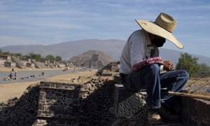 A vendor arranges his merchandise during the gradual reopening of the ancient Teotihuacan pyramids to public, as the coronavirus outbreak continues, in San Juan, Teotihuacan, Mexico.