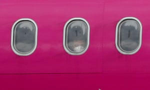 A passenger wearing a protective face mask aboard a Wizz Air flight at Luton Airport.